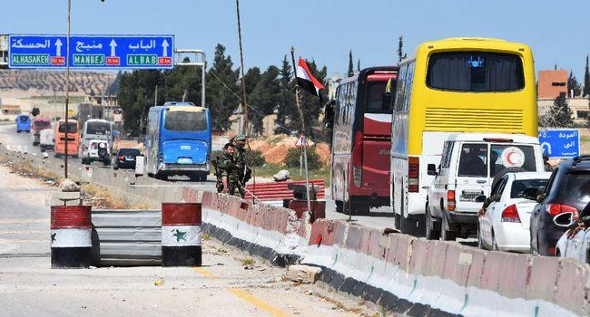 ميليشيات النظام تسرق السوريين - afp